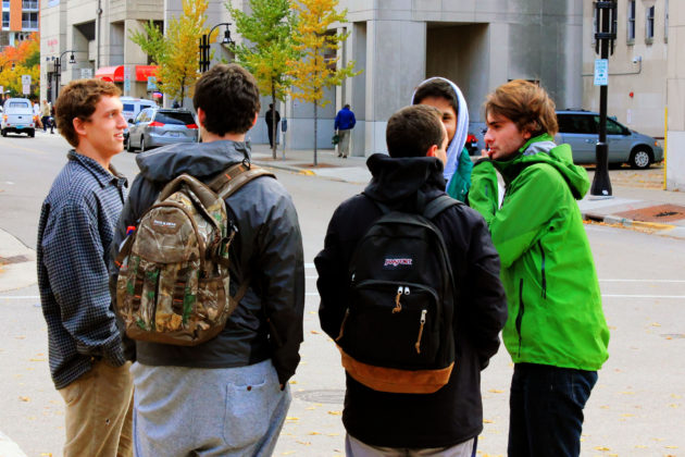some-students-standing-on-as-street-corner